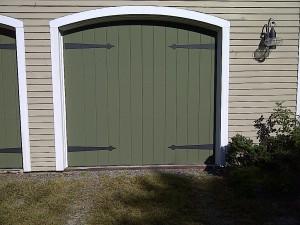 Green single residential garage door   Lewiston, ME